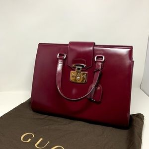 Wine colored Gucci top handle bag